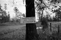 "Sign (""Dictatorship"") on tree, Powhatan County, Va., 1962-1963"